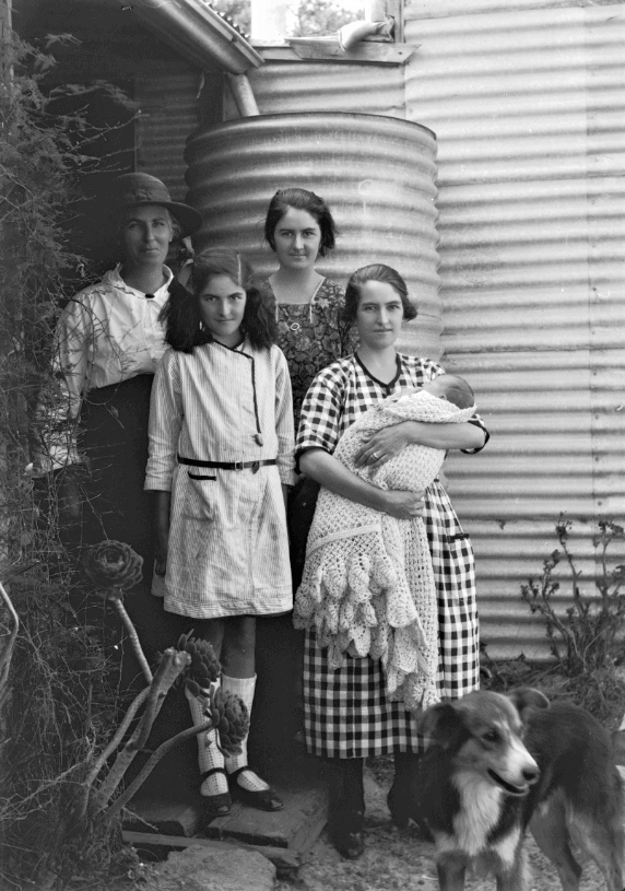 The Jenkins family and dog, Kalgoorlie Mackay, T. F. (Thomas Faulkner), 1884-1981. Photograph | 1923-1924. Available at Online (Call number: 033251PD)