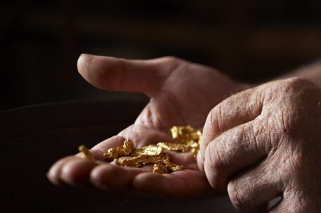 Gold nuggets found in the Kalgoorlie Boulder region of Western Australia. Gold nuggets sit in a hand.